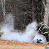ALLEGRA BOVERMAN/Staff photo. Essex: Essex firefighters put out three separate brush fires that grew from controlled burns at 32 Haskell Court in Essex on Tuesday.