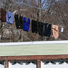 ALLEGRA BOVERMAN/Staff photo. Gloucester Daily Times. Gloucester: Mild temperatures and sun on Wednesday made it a good day to dry laundry outdoors on a clothesline on Pleasant Street.