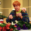 Peggy Fay of Rockport makes a Valentines bouquet on Wednesday afternoon at the Rockport Community Center. Jesse Poole/Gloucester Daily Times Feb. 8, 2012