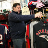 ALLEGRA BOVERMAN/Staff photo. Gloucester Daily Times. Gloucester: Jack Palazola, owner of Palazola's Sporting Goods, has been busy selling a variety of Patriots clothing, gear and accessories.