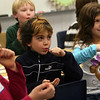 "ALLEGRA BOVERMAN/Staff photo. Gloucester Daily Times. Gloucester: Plum Cove Elementary School first graders learn to act out parts of ""Stone Soup,"" during the workshops held there on Friday afternoon. From left are: Megan Gething, Will Brown and Alexia Moran. The Stone Soup Arts & Literacy Enrichment Program is funded districtwide by the Gloucester Education Foundation and each elementary school's PTO, and it has been presented at each elementary school in the last couple of weeks. Stone Soup was also an actual cafeteria option for kids to eat at the elementary schools when the program was at each school."