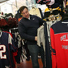 ALLEGRA BOVERMAN/Staff photo. Gloucester Daily Times. Gloucester: Jack Palazola, owner of Palazola's Sporting Goods in downtown Gloucester, has been busy selling Patriots clothing, accessories and gear.