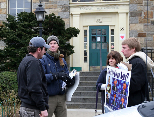 "ALLEGRA BOVERMAN/Staff photo. Gloucester Daily Times. Rockport: Supporters of Lyndon H. LaRouche Jr.  were demonstrating in front of the Rockport Post Office on Wednesday. Resident Kathy Gregg. second from right, let them know she was very offended by and ""vehemently object to"" the images on the posters they were showing."