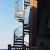 ALLEGRA BOVERMAN/Staff photo. Gloucester Daily Times. Rockport: This spiral stairway looks as though it might go right down to the water in Rockport.
