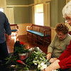 John Wonson, owner of Blue Gate Gardens in Rockport helps Marie Lacey, right, and Sally Kiely create beautiful Valentines Day bouquets on Wednesday afternoon at the Rockport Community Center. Jesse Poole/Gloucester Daily Times Feb. 8, 2012