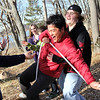 "ALLEGRA BOVERMAN/Staff photo. Gloucester Daily Times. Gloucester: In a ""tension traverse"" exercise, Takashi Monden, center, almost falls as he tries to carefully make his way on a low hanging rope as others stand ready to catch him if he were to fall. At far right, catching his fall, is Dylan Spellman, at far right is Kayla Collibee, and second from left is Nick Saulnier, Jaclyn Canillas and Miranda Schneider. Project Adventure of Gloucester High School and Project Adventure of Japan convened at the high school on Wednesday for activities."