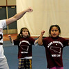 ALLEGRA BOVERMAN/Staff photo. Gloucester Daily Times. Gloucester: Almost 60 girls participated in the Gloucester Cheer Mini Camp this past week and they held a show for parents and friends on Thursday at the Gloucester High School field house. From left are sophomore Samantha Ryder with C1 team participants Malia Andrews, Ani Stephan and Ella Frontiero, all 5.