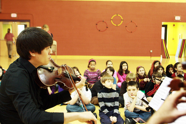 Frank Shaw plays the viola as he and three other members of A Far Cry musical group perform in front of a group of elementary students at the Gloucester Community Arts Charter School, where they also educated the students about classical music on Wednesday morning. The group performed at the Shalin Liu Performance Center in Rockport on Wednesday evening.  Jesse Poole/Gloucester Daily Times Feb. 29, 2012
