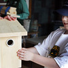 GLOUCESTER—Yishai Howe, 8, of Gloucester, looks proudly at the birdhouse he just made at the Cape Ann Discovery Center on Monday morning. Jesse Poole/Gloucester Daily Times Feb. 20, 2012