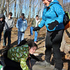 ALLEGRA BOVERMAN/Staff photo. Gloucester Daily Times. Gloucester: Tomo Seki, far right, of Project Adventure Japan, and Miranda Schneider, lower left, work to keep a platform balanced during activities with the Gloucester High School Project Adventure group at the school on Wednesday.