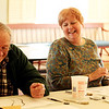 ALLEGRA BOVERMAN/Staff photo. Gloucester Daily Times. Rockport: From left, Alister Shaw and Peggy Fay, both of Rockport, share a laugh while drawing during a drawing class held at Community House in Rockport on Monday. The class will be held for four Mondays in February from 1-3 p.m. Call 978-546-2573 for more information. It is taught by artist Elizabeth Harty. In back is Bob Smith of Rockport.
