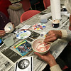 ALLEGRA BOVERMAN/Staff photo. Gloucester Daily Times. Gloucester: Grace Favazza, left, and Ed Hanson, both of Gloucester, work carefully on their bowls during the decorating night held at The Open Door Tuesday evening in preparation for the upcoming Empty Bowl Dinner on Thurs., May 10 from 4-8 p.m. at Cruiseport Gloucester. A second session for decorating will be held on Sat. Mar. 10 from 10 a.m. - noon at 28 Emerson Ave. in Gloucester. For more information, see foodpantry.org or call 978-283-6776, extension 205. Hanson's bowl is of the giant squid from the book 20,000 Leagues Under the Sea, and Favazza's is from a photo of bright blue flowers.