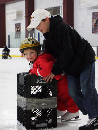 Gus Campbell, 12, pushes his little sister Caroline, 4, at the Dorothy Talbot Rink in Gloucester during a benefit skating event for the Rockport PTO and the Cape Ann Skating Club on Wednesday. Jesse Poole/Gloucester Daily Times Feb. 22, 2012