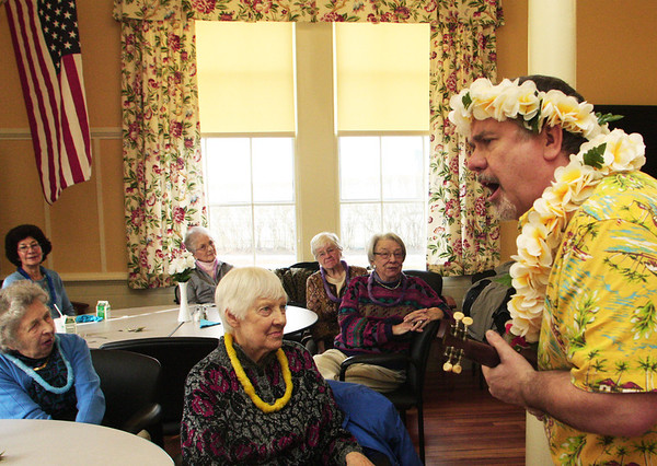 Kevin Prentice of Big Smile Entertainment plays on his little ukulele to a Beach Boys song in front of a group at the Rockport Community Center on Thursday afternoon. Jesse Poole/Gloucester Daily Times Feb.16, 2012