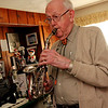 ALLEGRA BOVERMAN/Staff photo. Gloucester Daily Times. Roger Wonson playing a curved soprano saxophone at his home in Beverly.