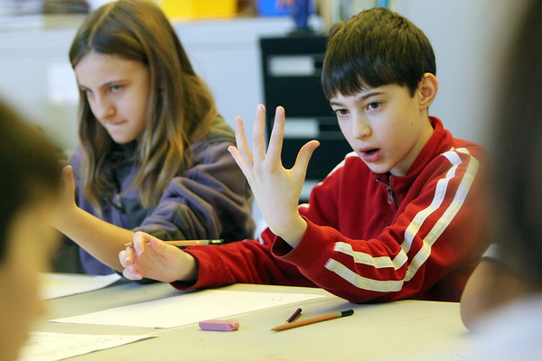 ALLEGRA BOVERMAN/Staff photo. Gloucester Daily Times. Gloucester: <br /> gloucester community arts charter school sixth graders Benjamin Smith, right, and Stephanie Strauss concentrate hard on drawing the palms of their hands in their art class on Friday morning at the school.
