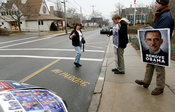"ALLEGRA BOVERMAN/Staff photo. Gloucester Daily Times. Rockport: Supporters of Lyndon H. LaRouche Jr.  were demonstrating in front of the Rockport Post Office on Wednesday. Resident Kathy Gregg let them know she was very offended by and ""vehemently object to"" the images on the posters they were showing."