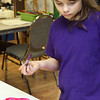 GLOUCESTER—Danielle Denman, 9, of Gloucester, works on painting a beautiful flower at Art Haven in Gloucester during the Paint Big event, at which children helped paint giant canvases on Monday morning. Jesse Poole/Gloucester Daily Times Feb. 20, 2012