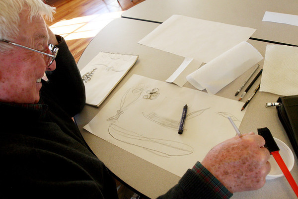 ALLEGRA BOVERMAN/Staff photo. Gloucester Daily Times. Rockport: <br /> Bob Smith of Rockport draws at Community House in Rockport on Monday. A drawing class taught by artist Elizabeth Harty will be held for four Mondays in February from 1-3 p.m. Call 978-546-2573 for more information.