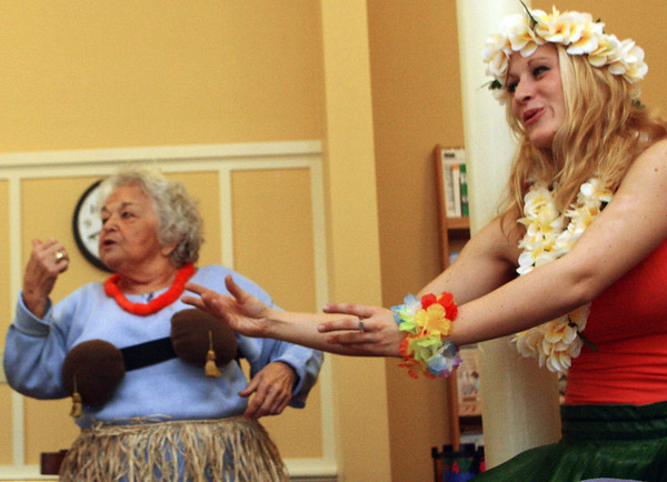Lisa Febonio of Lynn, right, teaches Kay Murphy and a few others how to do the hula dance as part of a special lunch event featuring Hawaiian song and dance by Big Smile Entertainment at the Rockport Community Center. Jesse Poole/Gloucester Daily Times Feb. 16, 2012