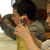 ALLEGRA BOVERMAN/Staff photo. Gloucester Daily Times. Gloucester: From front to back are Madison Dempsey, 10, Cameron Dempsey, 8, and Kaci Orlando, 7, making lava lamps using water, vegetable oil, Alka Seltzer and food coloring during the monthly science workshop held at the Sawyer Free Library on Tuesday. They were learning about the density of objects and liquids.
