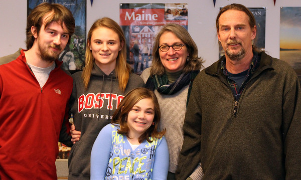 ALLEGRA BOVERMAN/Staff photo. Gloucester Daily Times. Manchester: Clare Fleuler, second from left, signed her letter of intent to attend Boston University to play soccer on Wednesday. She with her family. From left are Devin Pleuler, Maeve Pleuler, in front, Eileen Murphy and Dave Pleuler.