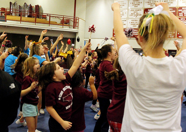 ALLEGRA BOVERMAN/Staff photo. Gloucester Daily Times. Gloucester: Almost 60 girls participated in the Gloucester Cheer Mini Camp this past week and they held a show for parents and friends on Thursday at the Gloucester High School field house.