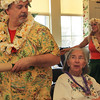 Kevin Prentice jokingly bumps up against Barbara Paradis at the Rockport Community Center on Thursday afternoon as he and the rest of Big Smile Entertainment do the hula dance and sing Hawaiian themed songs. Jesse Poole/Gloucester Daily Times Feb.16, 2012