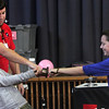 ALLEGRA BOVERMAN/Staff photo. Gloucester Daily Times. Gloucester: During a PTO-sponsored enrichment program at Beeman Elementary School on Friday given by the Museum of Science. Museum educator George Pechmann mediates the demonstration of electromagnetism between fifth graders Carlie Goulart, left, and Aiden Cunha.