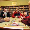 From left, George Moniz, William Pollack, 9, Henry conway, 10, Mark Pollack, 7, and Roger Dinapoli sit at the Manchester Public Library to a game of Cribbage on Thursday afternoon. Moniz and Dinapoli teach these young Manchester boys about the game once a week. Here, Dinapoli quizes the boys on what they learned the previous week. Jesse Poole/Gloucester Daily Times Feb 09, 2012