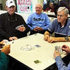 From left, Richard Doucette, Russell Moulton, Bob McKechnie, Vince Libro and Brad Thurston play a game of rummy at the Rose Baker Senior Center in Gloucester on Tuesday morning. Jesse Poole/Gloucester Daily Times Jan. 31, 2012
