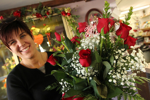 ALLEGRA BOVERMAN/Staff photo. Gloucester Daily Times. Gloucester: Heather Peterson, owner of Audrey's Flower Shop in Gloucester, is readying for the Valentine's Day rush. They received two shipments each of 1,500 roses on Friday and Saturday and were preparing the blooms for the creation of bouquets. They get a long line of customers on Tuesday for flowers, and some, she said, like to create their own floral arrangements with blooms of their choice from around the shop. The store typically sells 3,000 per Valentine's Day. They are also partnering with Just Nails by Nicki of Gloucester for gift certificates to add to the bouquets.
