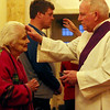 ALLEGRA BOVERMAN/Staff photo. Gloucester Daily Times. Rockport: Deacon William Kane of Saint Joachim's Catholic Church in Rockport, places ashes on the forehead of Frances Lucas of Gloucester during the Ash  Wednesday service there late Wednesday afternoon.