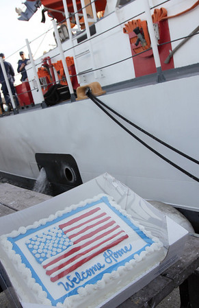 ALLEGRA BOVERMAN/Staff photo. Gloucester Daily Times. Gloucester:The Coast Guard Cutter Grand Isle returned to Gloucester on Friday afternoon after seven months of repairs and 10 days at sea. Cake was served in the mess for the crew and a few of their families.