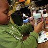 ALLEGRA BOVERMAN/Staff photo. Gloucester Daily Times. Gloucester: Nikodimos Strong, 6, of Gloucester, was pouring paint into palettes for people who were painting bowls during the decorating night held at The Open Door Tuesday evening in preparation for the upcoming Empty Bowl Dinner on Thurs., May 10 from 4-8 p.m. at Cruiseport Gloucester. A second session for decorating will be held on Sat. Mar. 10 from 10 a.m. - noon at 28 Emerson Ave. in Gloucester. For more information, see foodpantry.org or call 978-283-6776, extension 205.