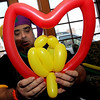ALLEGRA BOVERMAN/Staff photo. Gloucester Daily Times. Gloucester: Rick Doucette, Executive Director of Camping and Teen Service at the Cape Ann YMCA, created many unusual balloon animals on Tuesday during Mardi Gras festivities and the organization's full day fundraiser at Latitude 43. This is a pair of lovebirds inside a heart. The fundraiser is for Y teens and chaperones to travel to and volunteer in New Orleans during April school vacation and help rebuilt homes destroyed by Hurricanes Katrina and Rita.