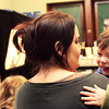MANCHESTER—Bryce Remington, 2, cracks up as his nanny Alicia Pike holds him and Jim Napolitano, otherwise known as Father Goose, uses shadow puppetry to tell the story of the old woman who swallowed a fly and other fairy tales at the Manchester Public Library on Wednesday morning. Jesse Poole/Gloucester Daily Times Feb. 22, 2012