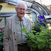 ALLEGRA BOVERMAN/Staff photo. Gloucester Daily Times. Roger Wonson in his greenhouse at his home in Beverly.