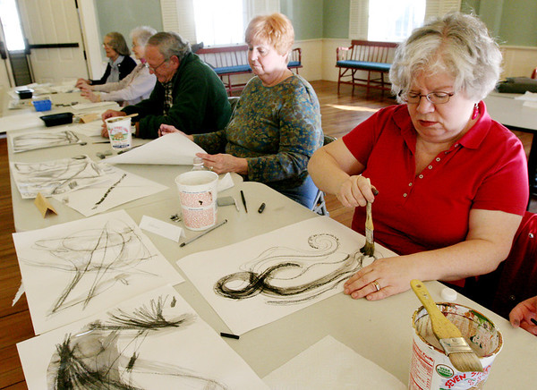 ALLEGRA BOVERMAN/Staff photo. Gloucester Daily Times. Rockport: Katherine Arthur of Manchester, right, paints and draws at Community House in Rockport on Monday. A drawing class taught by artist Elizabeth Harty will be held for four Mondays in February from 1-3 p.m. Call 978-546-2573 for more information. Next to her are: Peggy Fay, Alister Shaw and Joann Bell, all of Rockport, and Anthea Brigham of Gloucester.