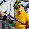 "ALLEGRA BOVERMAN/Staff photo. Gloucester Daily Times. Gloucester: Alex Jones, 17, right, is ""Jeffrey the Mardi Gras Chicken,"" and Shannon Gallagher, 17, is at left, as they advertise the Cape Ann YMCA fundraiser they're helping with that was taking place all day Tuesday at Latitude 43.  The fundraiser is for Y teens and chaperones to travel to and volunteer in New Orleans during April school vacation and help rebuilt homes destroyed by Hurricanes Katrina and Rita."