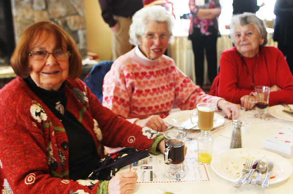 From left, Mary Bourguignon, Sue Holden and Dottie Carroll, all of Rockport, finish up their breakfast at the Meals on Wheels Valentine Breakfast Fund-raiser at the Gloucester House on Valentine's Day morning. Jesse Poole/Gloucester Daily Times Feb. 14, 2012