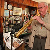 ALLEGRA BOVERMAN/Staff photo. Gloucester Daily Times. Roger Wonson playing a straight soprano saxophone at his home in Beverly.
