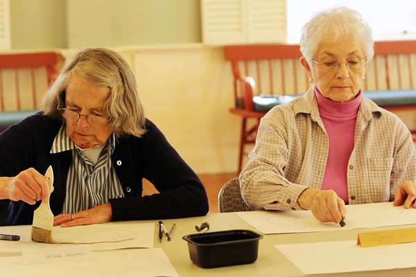 ALLEGRA BOVERMAN/Staff photo. Gloucester Daily Times. Rockport: From left, Anthea Brigham of Gloucester and Joann Bell of Rockport use various media to doodle on paper during the first session of a drawing class taught by artist Elizabeth Harty, at Community House in Rockport on Monday. The class will be held for four Mondays in February from 1-3 p.m. Call 978-546-2573 for more information.