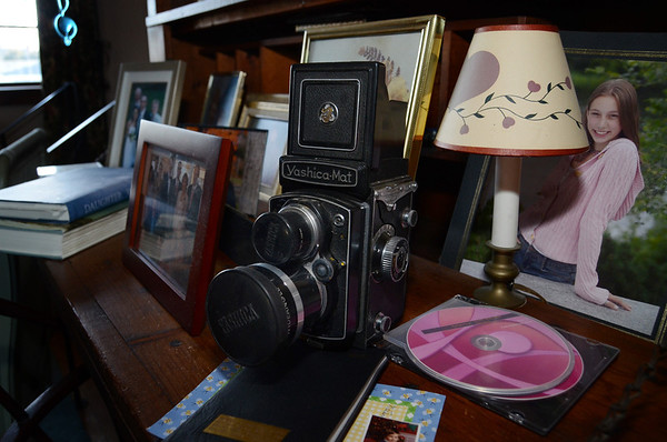 Photo Courtesy of Jake Levin/Gloucester Daily Times. Details of Roger Wonson's collection of old cameras at his home in Beverly.