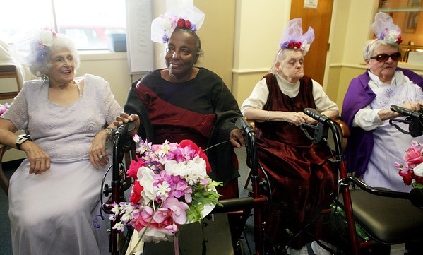 "ALLEGRA BOVERMAN/Staff photo. Gloucester Daily Times. Gloucester: From left, ""bridesmaids"" Angie Verga, Marsha West, Pat Shea, and Eleanor Campbell await the start of the ""Mock Wedding"" held at Day by Day on Tuesday."