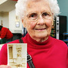 GLOUCESTER—In celebration of the up-coming Girl Scouts 100th Anniversary, Carolyn Parsons Hodgen of Gloucester brings a photo of herself at age 12, in 1934, to the Rose Baker Senior Center on Tuesday morning, where Girl Scouts of all ages met to reminisce, look at old Girl Scouts' scrapbooks, photos and uniforms, and to participate in the filming of a documentary about the history of the Girl Scouts on Cape Ann. Jesse Poole/Gloucester Daily Times Feb. 21, 2012