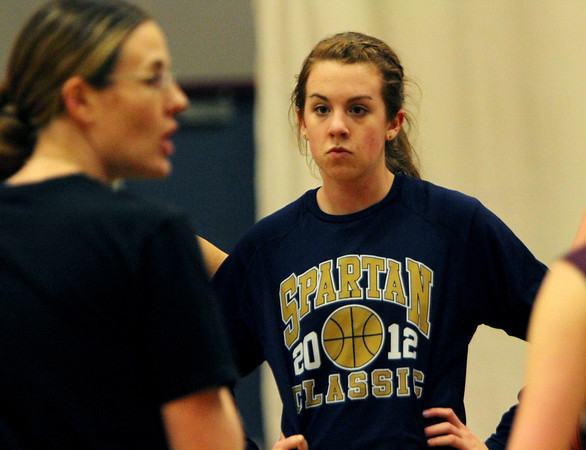 ALLEGRA BOVERMAN/Staff photo.Gloucester Daily Times. Gloucester: Gloucester's Sophie Black, right, during the girls varsity basketball team practice on Monday. Coach Lori Sanborn is at left.