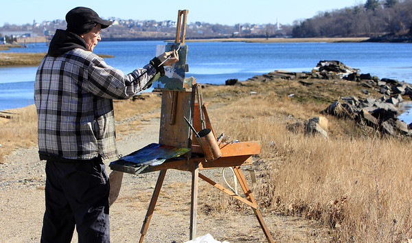 ALLEGRA BOVERMAN/Staff photo. Gloucester Daily Times. Gloucester: Dennis McQuillen of North Reading paints at Stony Pier along Route 128 on Monday. He was with a few other artists who like to do plein air painting.