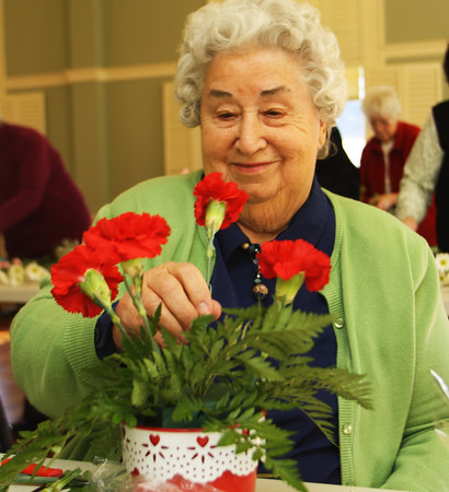 Lorraine Muise of Rockport puts a bouquet together in preparation for Valentines Day at the Rockport Community House on Wednesday afternoon. Jesse Poole/Gloucester Daily Times Feb. 8, 2012