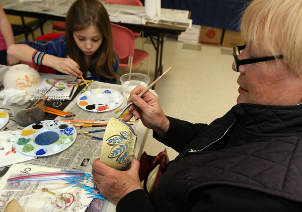 ALLEGRA BOVERMAN/Staff photo. Gloucester Daily Times. Gloucester: Sheila Schrank of Gloucester, right, and her step-granddaughter Alexis Wiswall, 12, of Revere, paint bowls together during the decorating night held at The Open Door Tuesday evening in preparation for the upcoming Empty Bowl Dinner on Thurs., May 10 from 4-8 p.m. at Cruiseport Gloucester. A second session for decorating will be held on Sat. Mar. 10 from 10 a.m. - noon at 28 Emerson Ave. in Gloucester. For more information, see foodpantry.org or call 978-283-6776, extension 205.